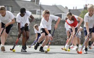 school children playing hockey
